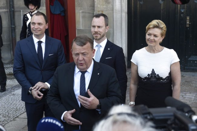 Newly appointed Minister of Education and Research Tommy Ahlers (L), Prime Minister Lars Loekke Rasmussen (Front), newly appointed Minister for Environment Jakob Ellemann-Jensen (Center Back) and newly appointed Minister for Fisheries, Equal Rights and Nordic Cooperation Eva Kjer Hansen (R) give a press statement in front of the Amalienborg Castle in Copenhagen, Denmark, on 2 May 2018 after the constitutional visit of the Danish Queen. (Photo by Liselotte Sabroe / Ritzau Scanpix / AFP) / Denmark OUT        (Photo credit should read LISELOTTE SABROE/AFP/Getty Images)