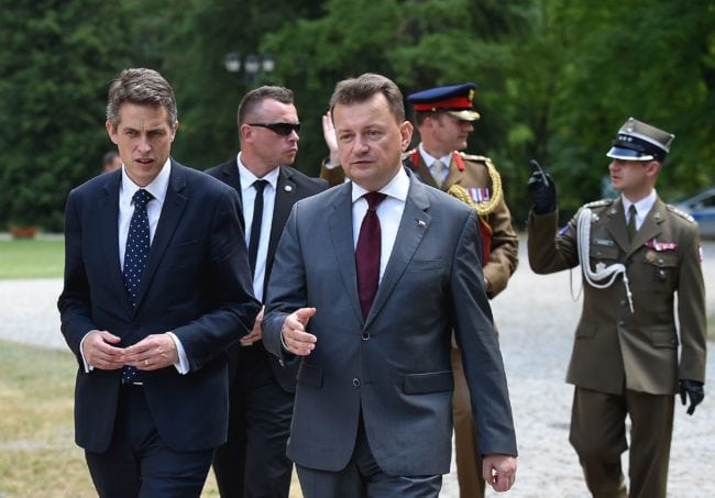 UK Defence Secretary Gavin Williamson (L) and Polish Defence Minister Mariusz Blaszczak walk together in Helenow, near Warsaw on June 21, 2018 at the begining of their talks about strengthening security, defence, and cyber ties between both countries. (Photo by JANEK SKARZYNSKI / AFP)        (Photo credit should read JANEK SKARZYNSKI/AFP/Getty Images)