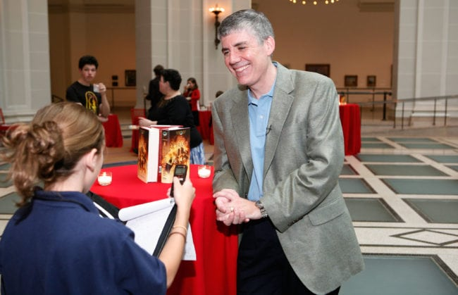 NEW YORK - MAY 03: Author Rick Riordan being interviewed at the launch party of Rick Riordan's The Kane Chronicles, Book 1: The Red Pyramid at Brooklyn Museum on May 3, 2010 in the Brooklyn borough of New York City.  (Photo by Amy Sussman/Getty Images for Disney)