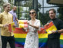 Fillmaker Romas Zabarauskas (left) and LGBT+ activists handing out free Pride flags in Vilnius on Friday. (Arcana Femina)