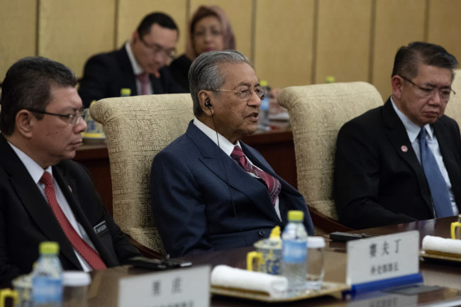 BEIJING, CHINA - AUGUST 20: Malaysian Prime Minister Mahathir Mohamad (C) speaks to Chinese President Xi Jinping (not pictured) during their meeting at Diaoyutai State Guesthouse on August 20 2018 in Beijing, China. (Photo by Roman Pilipey - Pool/Getty Images)