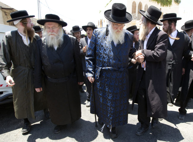 Rabbi Sternbuch (2nd-R) leaves after a protest against the removal of ancient tombs in Jaffa, just south of Tel Aviv, on June 14, 2010 where construction is due to take place at the site where religious men say Jewish graves are located. AFP PHOTO/JACK GUEZ (Photo credit should read JACK GUEZ/AFP/Getty Images)