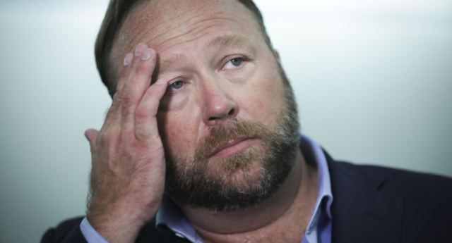 Apple bans Alex Jones app for 'objectionable content'