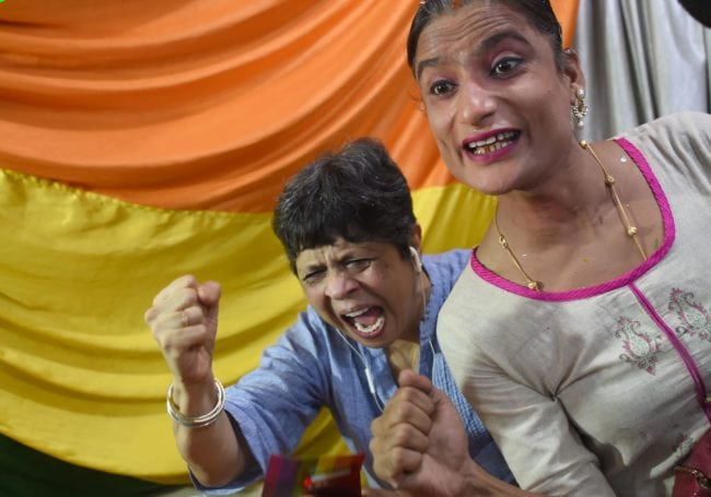 "Indian members and supporters of the lesbian, gay, bisexual, transgender (LGBT) community celebrate the Supreme Court decision to strike down a colonial-era ban on gay sex, in Mumbai on September 6, 2018. - India's Supreme Court on September 6 struck down the ban that has been at the centre of years of legal battles. ""The law had become a weapon for harassment for the LGBT community,"" Chief Justice Dipak Misra said as he announced the landmark verdict. (Photo by INDRANIL MUKHERJEE / AFP) (Photo credit should read INDRANIL MUKHERJEE/AFP/Getty Images)"