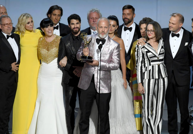 LOS ANGELES, CA - SEPTEMBER 17: Ryan Murphy (C) and cast and crew accepts the Outstanding Limited Series award for 'The Assassination of Gianni Versace: American Crime Story' onstage during the 70th Emmy Awards at Microsoft Theater on September 17, 2018 in Los Angeles, California. (Photo by Kevin Winter/Getty Images)