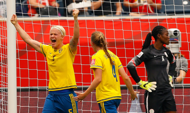 WINNIPEG, MB - JUNE 08:  Nilla Fischer #5 of Sweden reacts after scoring the second goal against goalkeeper Precious Dede #1 of Nigeria with Emma Berglund #4 during the FIFA Women's World Cup Canada 2015 Group D match between Sweden and Nigeria at Winnipeg Stadium on June 8, 2015 in Winnipeg, Canada.  (Photo by Kevin C. Cox/Getty Images)