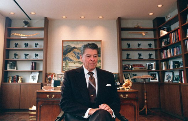 Former US President Ronald Reagan sits 09 June 1989 in his office in Century City near Los Angeles. Reagan was US president from 1980 to 1988. (Photo credit should read CARLOS SCHIEBECK/AFP/Getty Images)