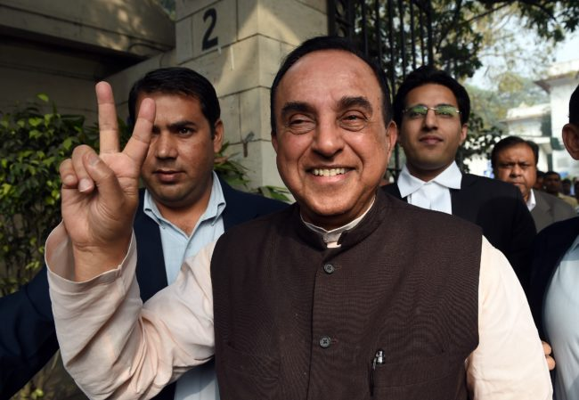 "Bhartiya Janata Party (BJP) leader Subramanian Swamy flashes a victory sign as he leaves the Patiala House court in New Delhi on December 8, 2015. Swamy filed a case against rival politicians Sonia Gandhi and Rahul Gandhi alleging fraud and land grabbing in an ongoing saga known as the ""National Herald case"". AFP PHOTO / PRAKASH SINGH / AFP / PRAKASH SINGH (Photo credit should read PRAKASH SINGH/AFP/Getty Images)"