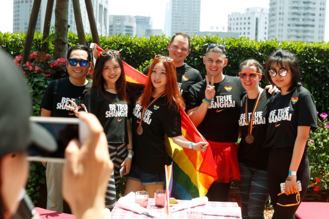 A group poses for photos after taking part in the Pride Run in Shanghai on June 17, 2017. The run was part of Shanghai's ninth annual gay-pride festival. / AFP PHOTO / STR / China OUT (Photo credit should read STR/AFP/Getty Images)