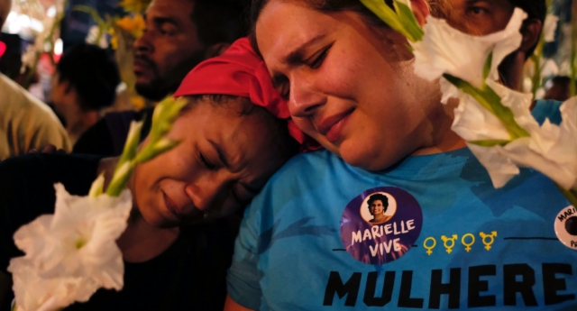 Women cry at a march while mourning activist Marielle Franco (DIEGO HERCULANO/AFP/Getty)