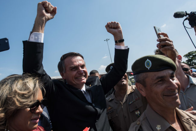 Brazilian congressman and presidential canditate for the next election, Jair Bolsonaro (R), cheer the crowd during a military event in Sao Paulo, Brazil on May 3, 2018. (Photo by Nelson ALMEIDA / AFP) (Photo credit should read NELSON ALMEIDA/AFP/Getty Images)