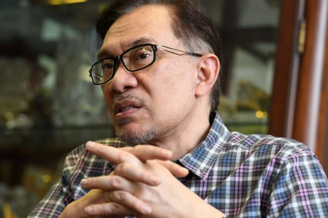 Newly released Malaysian politician Anwar Ibrahim gestures during an interview with AFP at his house in Kuala Lumpur on May 17, 2018. - Newly released Malaysian political heavyweight Anwar Ibrahim said on May 17 he expects ex-premier Najib Razak to be jailed over multi-billion-dollar graft claims. (Photo by Roslan RAHMAN / AFP) / TO GO WITH Malaysia-politics-Anwar, INTERVIEW (Photo credit should read ROSLAN RAHMAN/AFP/Getty Images)