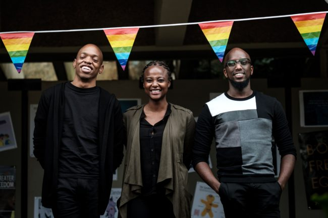 """The Nest Collective Director Tim Chuchu (L), Production Designer Summy Dolat (R) and Producer Njeri Gitungo pose after their keynote speech on their film """"The Stories of Our Lives"""" banned screening in Kenya for LGBT theme during the UN GLOBE event celebrating first time on the International Day against Homophobia and Transphobia (IDAHOT), on May 17, 2018, at United Nations Office in Nairobi, Kenya. - UN GLOBE is a staff group representing lesbian, gay, bisexual, transgender, and inter-sex staff members of the UN and its peacekeeping operations. (Photo by Yasuyoshi CHIBA / AFP) (Photo credit should read YASUYOSHI CHIBA/AFP/Getty Images)"""