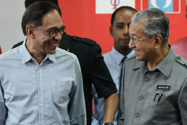 Malaysia's Prime Minister Mahathir Mohamad (R) and politician Anwar Ibrahim, leave after a press conference in Kuala Lumpur on June 1, 2018. (Photo by Mohd RASFAN / AFP) (Photo credit should read MOHD RASFAN/AFP/Getty Images)