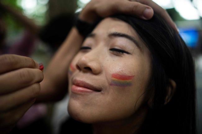 A participant prepares for a Pride Run, an event of the ShanghaiPRIDE LGBT (lesbian, gay, bisexual and transgendered) celebration in Shanghai, June 9, 2018. (Photo by Johannes EISELE / AFP) (Photo credit should read JOHANNES EISELE/AFP/Getty Images)