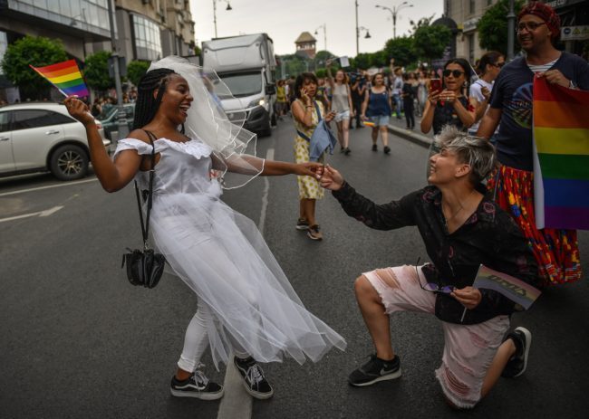 People take part in the Bucharest Pride 2018 March gay pride parade on June 9, 2018. (Photo by Daniel MIHAILESCU / AFP)        (Photo credit should read DANIEL MIHAILESCU/AFP/Getty Images)