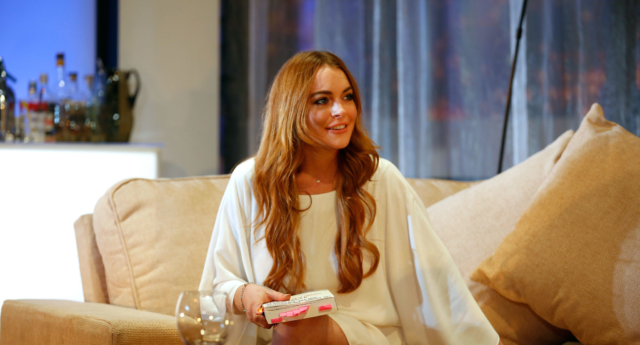 Lindsay Lohan accuses woman of trafficking kids, gets punched