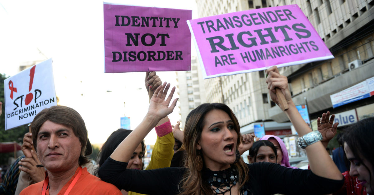 Pakistani transgenders carry placards as they rally to mark World Aids Day in Karachi on November 30, 2013. (Asif Hassan/AFP/Getty)