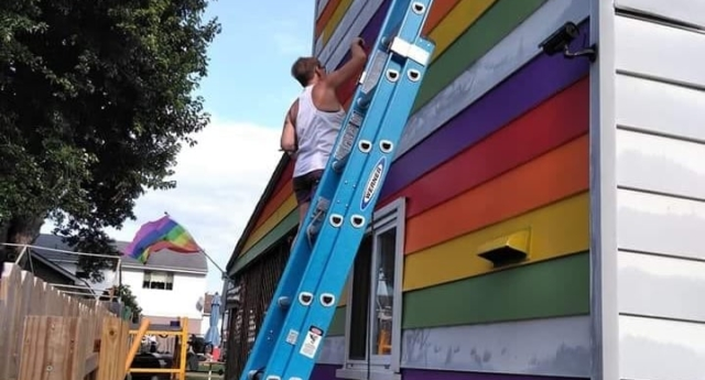Lesbian couple paints house in rainbow colours to troll anti-gay neighbours who harassed them Pride-house_640x345_acf_cropped