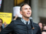 US Olympic figure skating bronze medalist Adam Rippon speaks at a rally calling on Sen. Jeff Flake to reject Judge Brett Kavanaugh's nomination to the Supreme Court on October 1, 2018 (Scott Eisen/Getty)