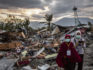People survey the damage done in Palu, Central Sulawesi, Indonesia last week (Ulet Ifansasti/Getty)