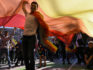Kosovo citizens dance under a giant rainbow flag during the Pride parade in Pristina on October 10, 2018 (ARMEND NIMANI/AFP/Getty)