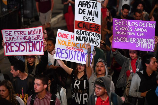 Demonstrators take part in a protest against Brazilian right-wing presidential candidate Jair Bolsonaro in Sao Paulo, Brazil, on October 10 2018. - The populist ultra-conservative won 46 percent of the vote in the first round, despite detractors highlighting his contentious past comments demeaning women and gays, and speaking in favor of torture and Brazil's 1964-1985 military dictatorship. Brazil will hold the run-off presidential election next October 28. (Photo by NELSON ALMEIDA / AFP) (Photo credit should read NELSON ALMEIDA/AFP/Getty Images)