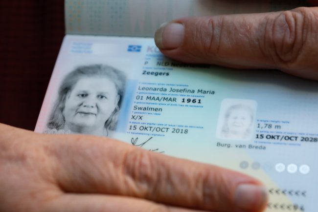 Leonne Zeegers, 57, receives a passeport with the gender designation X, instead of M for man or V for woman in Breda, on October 19, 2018. - The first gender-neutral passport of The Netherlands was issued. (Photo by Bas Czerwinski / ANP / AFP) / Netherlands OUT (Photo credit should read BAS CZERWINSKI/AFP/Getty Images)