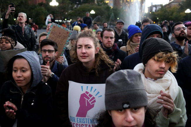 """NEW YORK, NY - OCTOBER 21: People gather at a rally for LGBTQI+ rights at Washington Square Park on October 21, 2018 in New York City. Based on a leaked memo, The New York Times had reported that morning that the Trump administration is considering re-defining gender as a """"biological, immutable condition determined by genitalia at birth,"""" which activists say would subject transgender and gender nonconforming people to discrimination, harassment, and violence. (Photo by Yana Paskova/Getty Images)"""