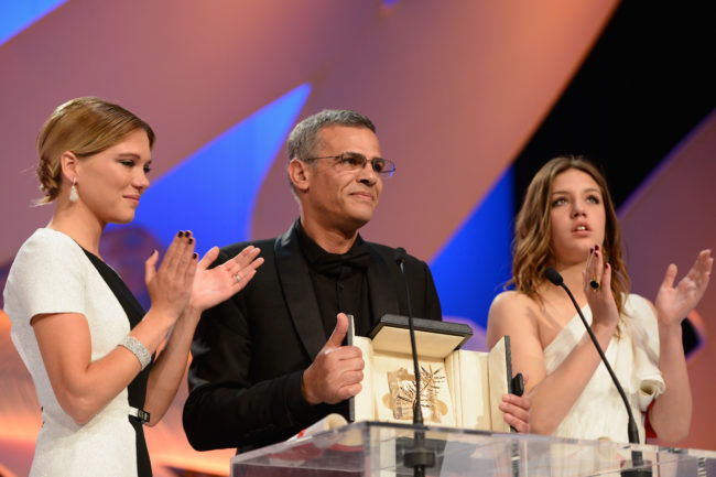 CANNES, FRANCE - MAY 26: (L-R) Actress Lea Seydoux, director Abdellatif Kechiche and actress Adele Exarchopoulos speak on stage after 'La Vie D'adele' receives the Palme D'or' at the Inside Closing Ceremony during the 66th Annual Cannes Film Festival at the Palais des Festivals on May 26, 2013 in Cannes, France. (Photo by Pascal Le Segretain/Getty Images)