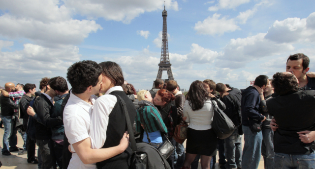 "People kiss in Paris, on May 16, 2010, during a ""kiss-in"" operation for the world day against homophobia. (Jacques Demarthon/AFP/Getty)"