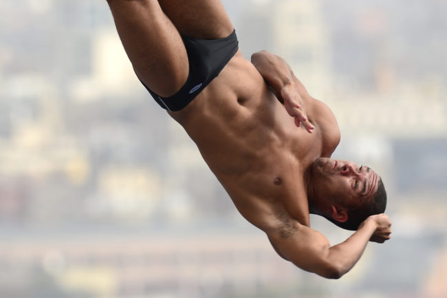 Venezuela's Robert Paez competes in the men's 10-metre platform preliminary diving event in the FINA World Championships at the Piscina Municipal de Montjuic in Barcelona on July 27, 2013. AFP PHOTO / LLUIS GENE (Photo credit should read LLUIS GENE/AFP/Getty Images)