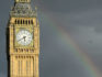 A rainbow appears over Parliament. (LEON NEAL/AFP/Getty)