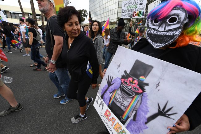 Members of the LGBT community and their supporters participate in the #ResistMarch at the 47th annual LA Pride Festival in Hollywood, California on June 11, 2017. Inspired by the huge women's marches that took place around the world following the inauguration of President Trump, LA Pride has replaced its decades-old parade with a protest march. / AFP PHOTO / Robyn Beck (Photo credit should read ROBYN BECK/AFP/Getty Images)