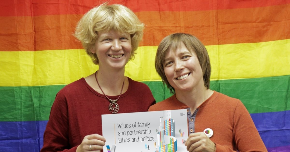 Founders of the conference Anna and Yulia with this years Family Conference Logo (Supplied)