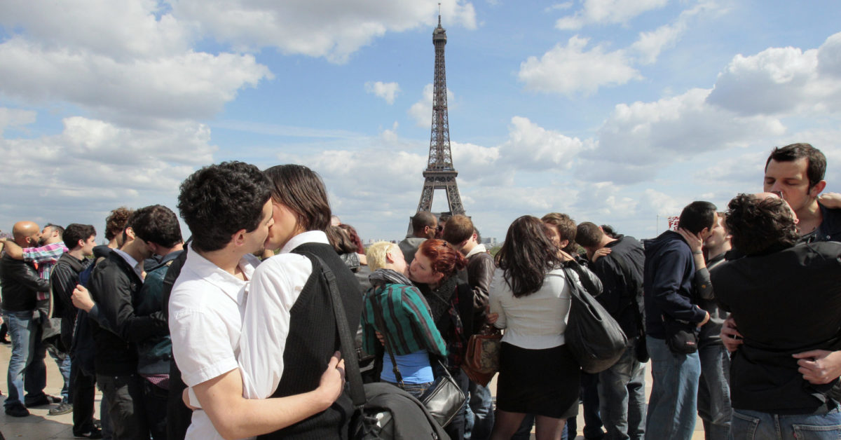 """People kiss in Paris, on May 16, 2010, during a """"kiss-in"""" operation for the world day against homophobia. (Jacques Demarthon/AFP/Getty)"""