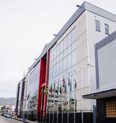 Flags of member countries fly outside the Caribbean Court of Justice (CCJ)