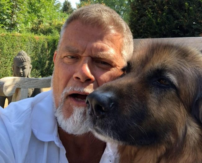Emile Ratelband, who is suing to change his age, with a dog
