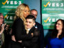 Laverne Cox and Chase Strangio of the ACLU embrace at a Yes on 3 event (Natasha Moustache/Getty)