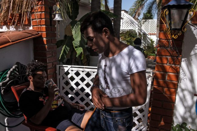 One of the LGBT+ asylum seekers rest at the rented accommodation in Tijuana.