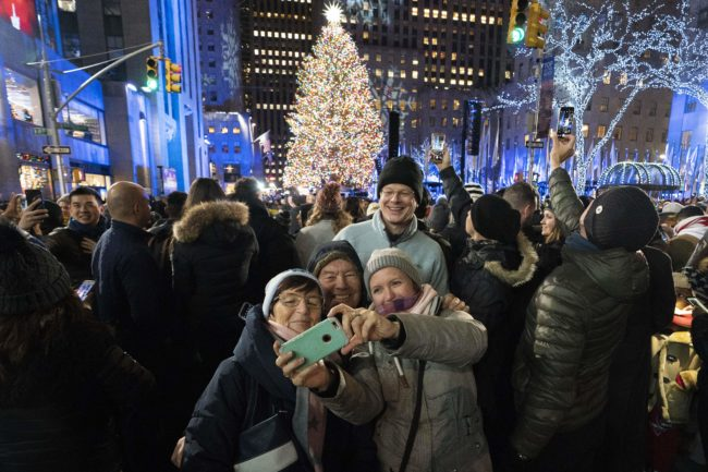 People gather around the Rockefeller Center tree.