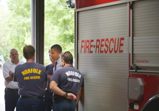 US President Barack Obama chats with firefighters during an unannounced stop at Fire Station No. 14 September 4, 2012 in Norfolk, Virginia, where the gay firefighters served until 2017.