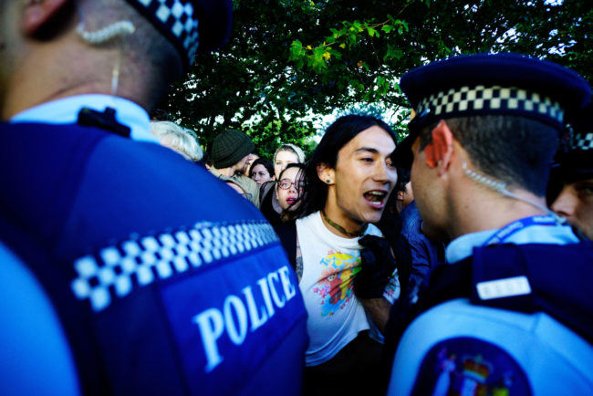 Protesters make a stand for their rights as the New Zealand police arrive at the Auckland Pride Party on February 20, 2016 in Auckland, New Zealand.