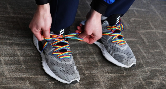 Skeleton athlete Lizzy Yarnold of Great Britain ties a pair of rainbow shoelaces which signify support for LGBT rights on February 11, 2018 in Pyeongchang-gun, South Korea (Ker Robertson/Getty)