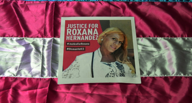"""A poster demanding justice in the death of Honduran transgender woman Roxana Hernandez, is seen at the Pink Unity Collective headquarters in San Pedro Sula, on June 3, 2018. - Hernandez, 33, died of pneumonia, dehydration and """"complications associated with HIV,"""" while in the custody of immigration authorities in the US state of New Mexico, according to US Immigration and Customs Enforcement officials. (Photo by Orlando Sierra/AFP/Getty)"""