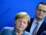 German Health Minister Jens Spahn stands behind German Chancellor Angela Merkel (TOBIAS SCHWARZ/AFP/Getty)