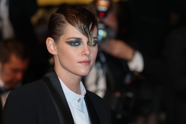 Kristen Stewart poses as she arrives at the Cannes Film Festival