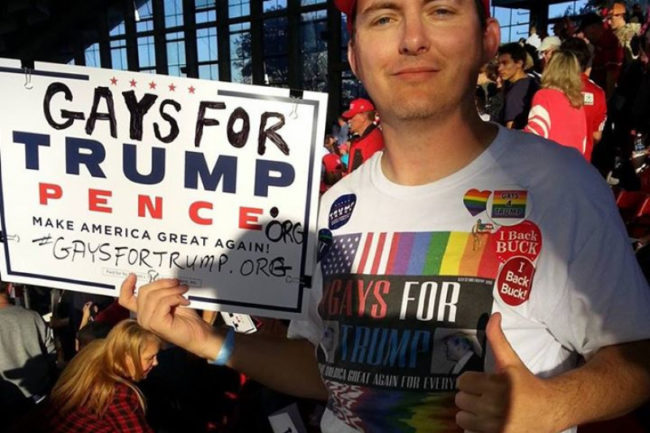 Peter Boykin poses with a 'Gays for Trump' sign