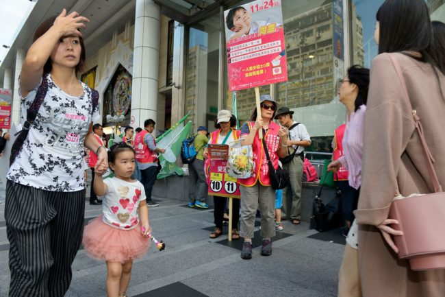Anti-gay marriage activists hand out leaflets in Taiwan