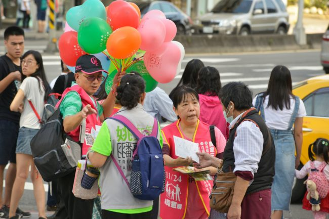 Anti-gay marriage campaigners hand out leaflets in Taipei